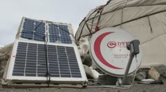 Solar panels, satellite dish, old and new, traditional yurt, nomadic existence Stock Footage