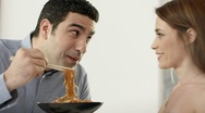 Couple having fun with spaghetti and chopsticks Stock Footage