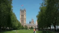 Victoria tower memorial and Palace of Westminster Stock Footage