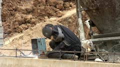Workers at a construction site. Welding of metal. Stock Footage