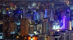 The city has a very tall building at night with a light house in Bangkok - stock footage