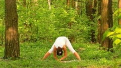 Young woman doing yoga Stock Footage