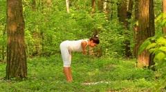 Young woman doing yoga Stock Footage