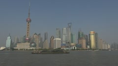 View of Shanghai Pudong with boat traffic, China Stock Footage