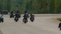 Outlaw motorbikes stop at intersection Stock Footage