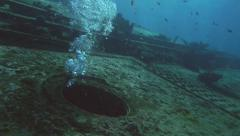 Airbubbles coming out of sunken metal ship, red sea Stock Footage
