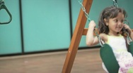 Little girl on swing 3 Stock Footage