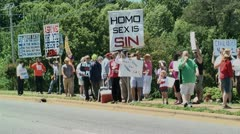 Anti gay protestors at Gay protest of local preacher 5 27 12 Stock Footage