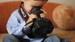 Stock Video Footage of Child in denim dress funny looks into a lens with the wrong side of camera