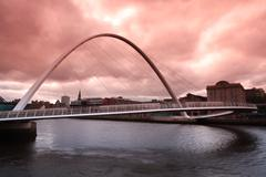 dusk over the millenium bridge in newcastle upon tyne - stock photo
