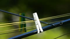 Pegs on washing line Stock Footage