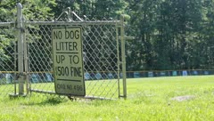Warning Sign on baseball Field Reads No Dog Litter Stock Video - stock footage