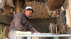Traditional wood cutting shop in old town of Kashgar, China Stock Footage