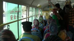 Riding a bus with Uyghur passengers in a Xinjiang village, China Stock Footage
