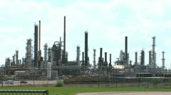 Train Passing by Oil Refinery Stock Footage