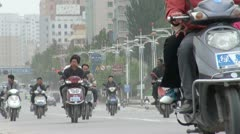 Busy street in Kashgar, motorbikes, cars, taxis and other vehicles Stock Footage