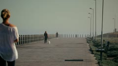 Woman jogging down the coastal walk. Stock Footage