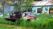 Stock Video Footage of Old Truck In Rundown Area Of Mountain Town