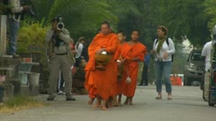 Luang phabang laos closeup of monks getting alms tithes with rice bowls and o Stock Footage