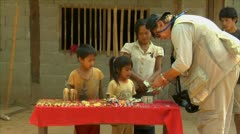 Luang phabang laos lao tourist buying souvenirs from mother and children in s Stock Footage