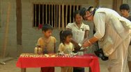 Stock Video Footage of luang phabang laos lao tourist buying souvenirs from mother and children in s