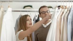 Man talking with sales assistant in clothes shop Stock Footage