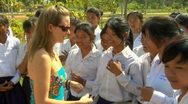 Siem reap cambodia school children in high school taking with tourist woman i Stock Footage
