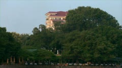 hanoi vietnam viet nam truc bach lake paddle boats with a skyline and locals  - stock footage