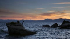 Bonsai Rock, Lake Tahoe, at dusk (pan) Stock Footage
