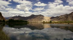 Time-lapse of Tingri and mountain landscape, Tibet - stock footage