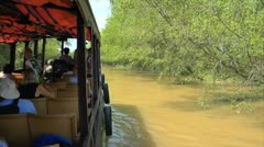 Mekong delta vietnam viet nam tourist boat on the muddy river Stock Footage