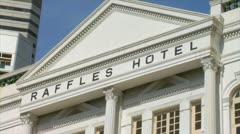 Singapore famous raffles hotel luxury resort in front one of the worlds great Stock Footage