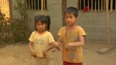 Luang phabang laos lao children dancing and singing in small village Stock Footage