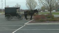 Amish Carriage Parked In A Car Park Stock Footage