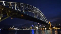 Sydney Australia night time of famous Sydney Opera House with ferry boat and Stock Footage