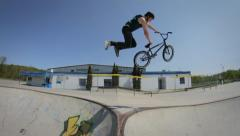 BMXer does a superman over a skatepark hip Stock Footage