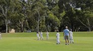 Stock Video Footage of Melbourne Australia young boys aged 8 to 10 playing crickett in the park of