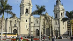 lima peru cathedral with traffic and people in the main square of the center  - stock footage