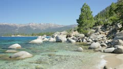 Small, rocky bay, east shore Lake Tahoe Stock Footage