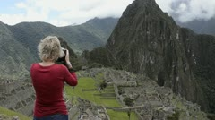 Stock Video Footage of machu picchu peru the famous ruins of the incas with woman photographer takin