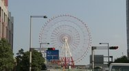 Stock Video Footage of Odaiba, Tokyo, Japan, Ferris Wheel, Airplane crossing 3