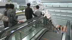 Busy escalators in Hong Kong China traffic pedestrian people go down up stairs  - stock footage