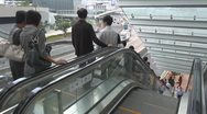 Busy escalators in Hong Kong China traffic pedestrian people go down up stairs  Stock Footage