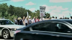 Gay protestor with police car 5 27 12 - stock footage