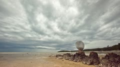 Storm clouds of rain floating above a tropical beach with shell decoration - stock footage