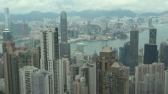 Panoramic panorama view pan right aerial view Hong Kong city cloudy day China Stock Footage