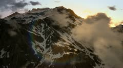 Stock Video Footage of Mountain Sunrise Through the Clouds