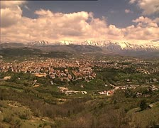 LAQUILA full cityscape with mountains and clouds Stock Footage