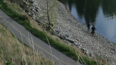 Stock Video Footage of Fishing and bikes 1