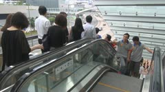 Busy escalators in Hong Kong China people commuter go down up corporation Asia - stock footage